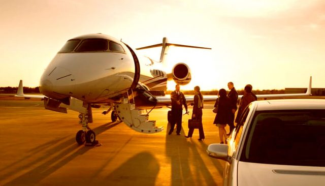 Image of a private jet crew, pilot and passengers at airport