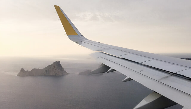 Image of a private passenger logistics jet wing over the sea
