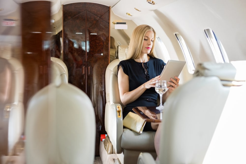 Business woman meeting private jet