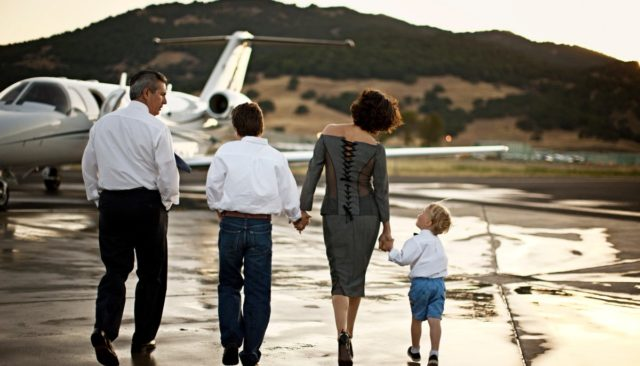 family headed to private jet